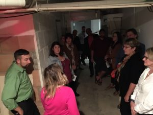 Stacy Sturm (in pink) hosts a Haunted History tour that included a look into tunnels under downtown Bismarck.
